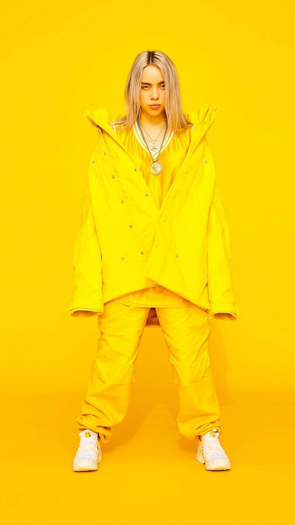 950x1689 Tải xuống Billie Eilish Yellow Yellow Background Miễn phí Pure 4K Ultra