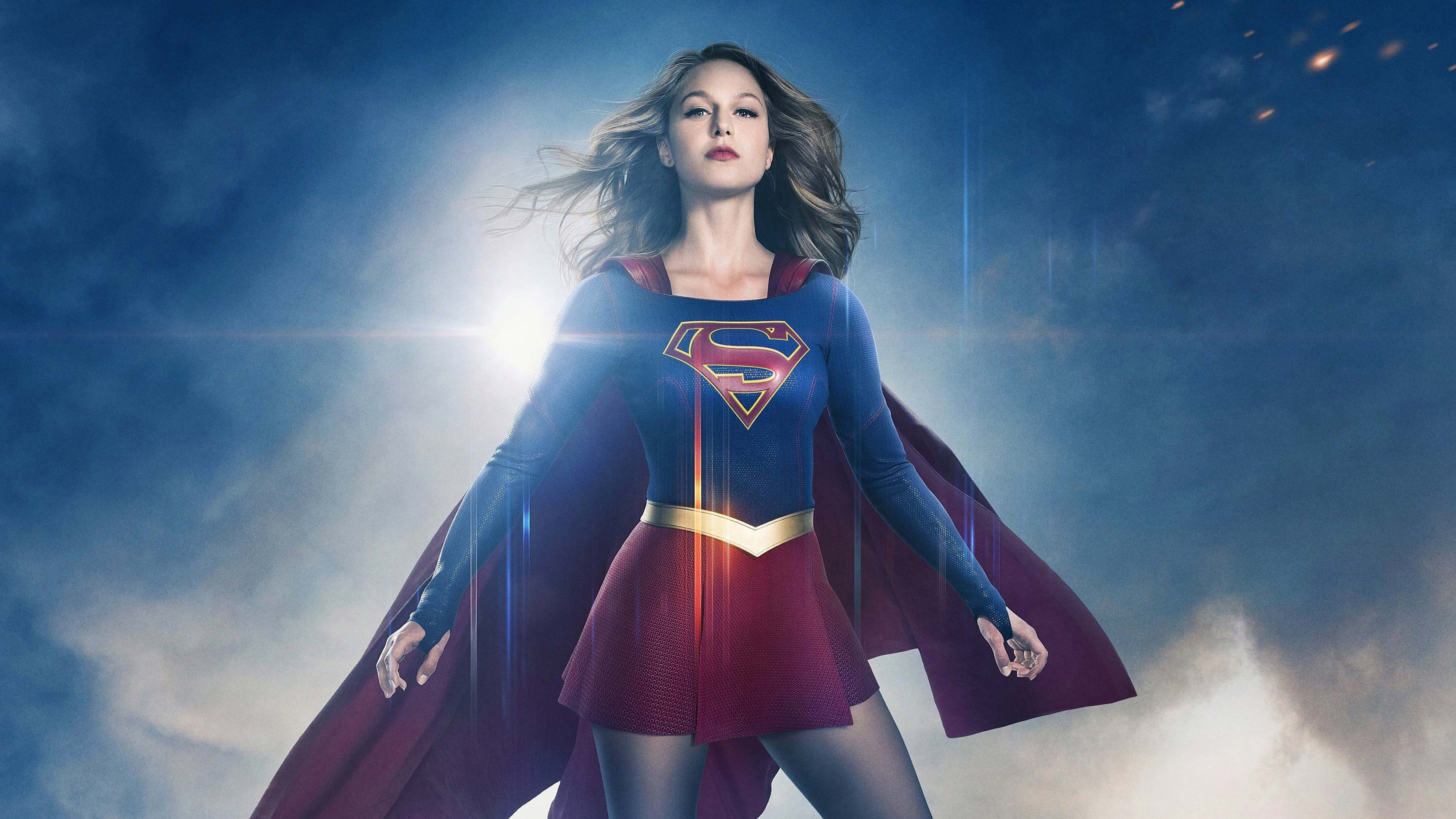 Desktop wallpaper style photo of Supergirl, played by Melissa Benoist, posed powerfully